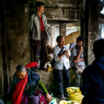 Taking shelter from the rain in Cherrapunji